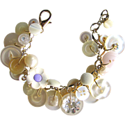 Charm Bracelet of Vintage Buttons in Peaches and Cream Shades – MOP – Lucite – Glass – Silk