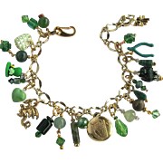 Good Luck Charm Bracelet with Four Leaf Clovers – a Dragon – Celtic Harp Button - Wishbone