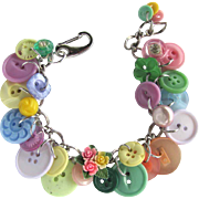 Charm Bracelet of Vintage Buttons in Pastel Shades with Unique Flower Button Focal