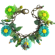 Charm Bracelet of Daisies in Bold Green and Turquoise Colors with Bees and Crystals