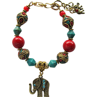 Bracelet of Tibetan Mosaic and Turquoise Beads with Elephant Charms and Red Accents