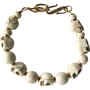 Skull Bracelet of Off-White Howlite Skulls and Magnesite Beads