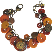 Charm Bracelet of Vintage Buttons in Autumn Shades with Unique Focal Button and Bobcat