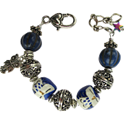 Bracelet of Hand-Painted Owls in Blue and White with Filigree Bead Accents