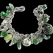 Charm Bracelet with Lucky Charms – Leprechaun's hat – Dragon – Wishbone – Celtic Harp – Shamrocks