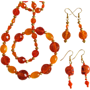 Orange Necklace and Matching Earrings of Fire-Polished Beads with Additional Matching Skull Earrings