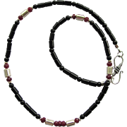 Men's Necklace of Black Onyx with Faceted Ruby Rondelles and Sterling Silver Accents