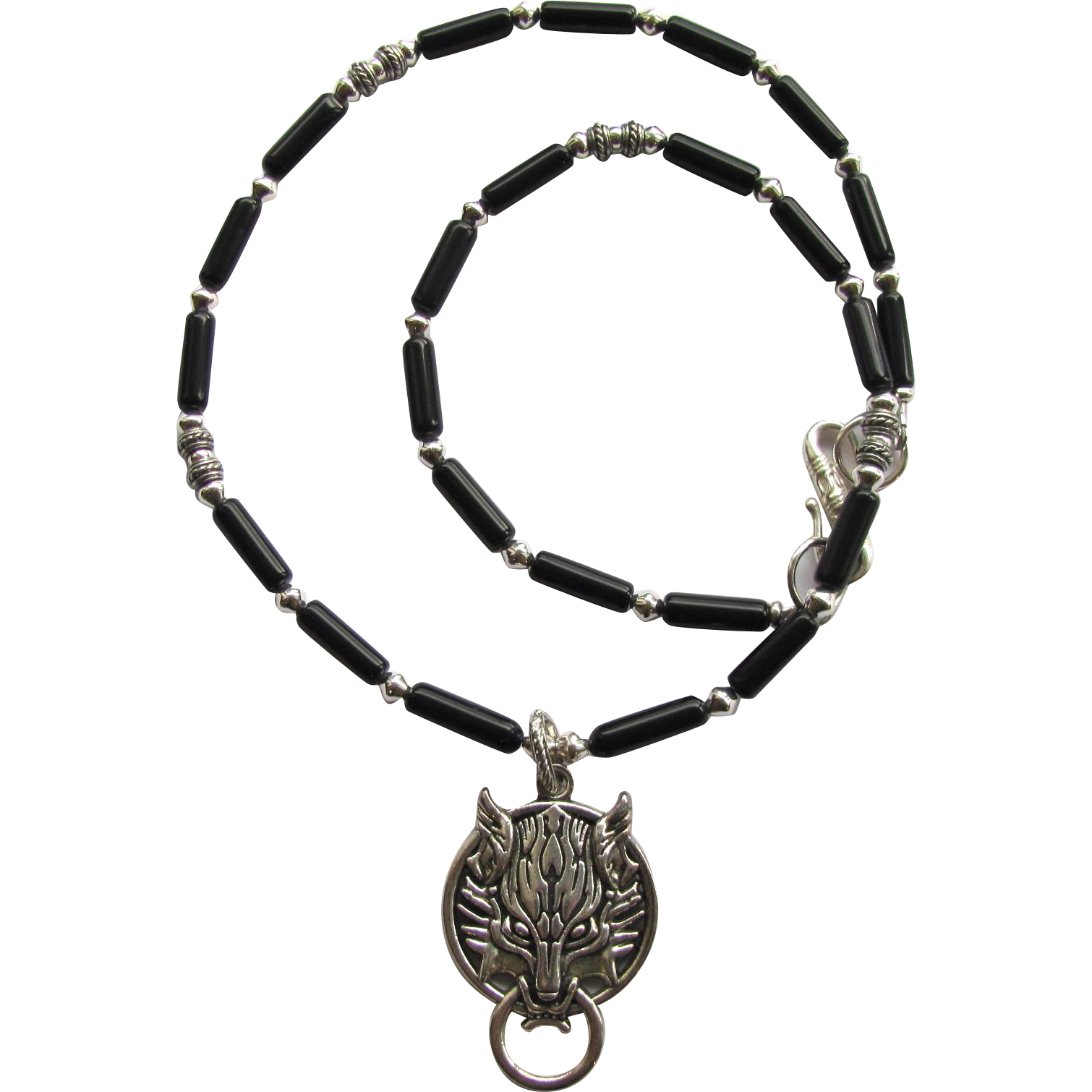 wolf pendant on s necklace of black obsidian with