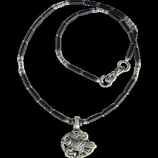 Celtic Raven Pendant on Necklace of Black Riverstone and Hematite
