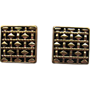 Vintage Cufflinks with Bar and Diamond Shaped Design Against Black Background