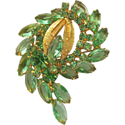 Vintage Brooch in Light Green and Gold Colors with Sparkling Rhinestones in Swirl Design
