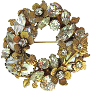 Vintage Signed Regency Floral Brooch Embellished with Rhinestones in Clear and Gold Colors