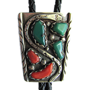 Rattlesnake Bolo by Zuni Artist Wayne Cheama in Sterling Silver with Turquoise and Coral