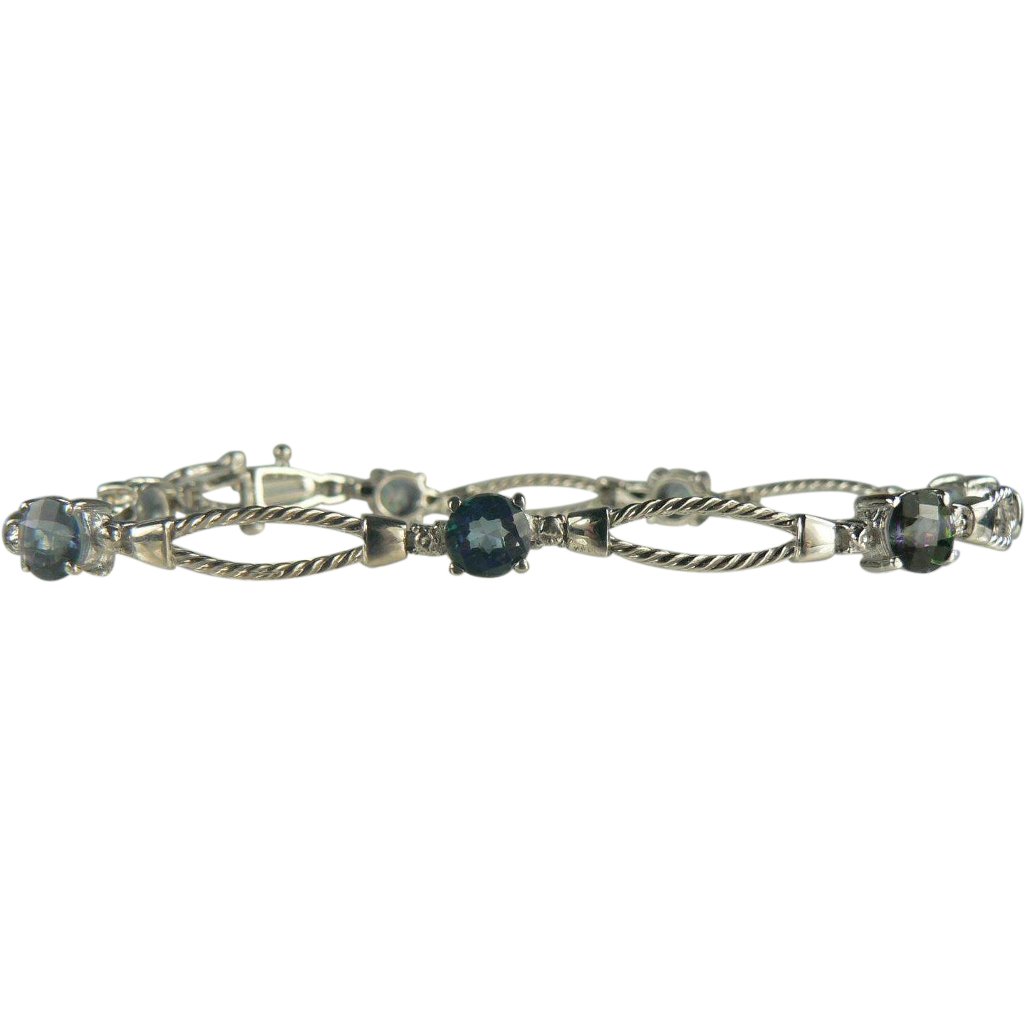 Striking Blue Topaz & Diamond Bracelet~10k..