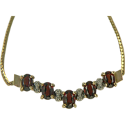 Garnet & Diamond Necklace in 10k Yellow Gold.