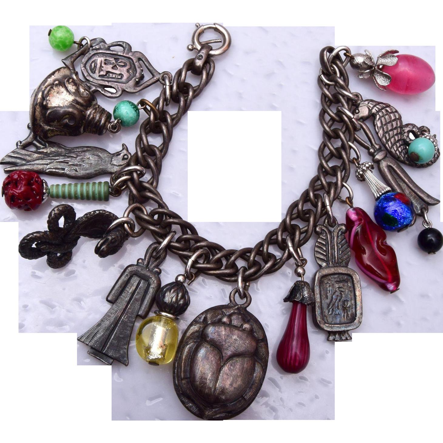 Napier Egyptian Silver Tone and Glass Charm Bracelet