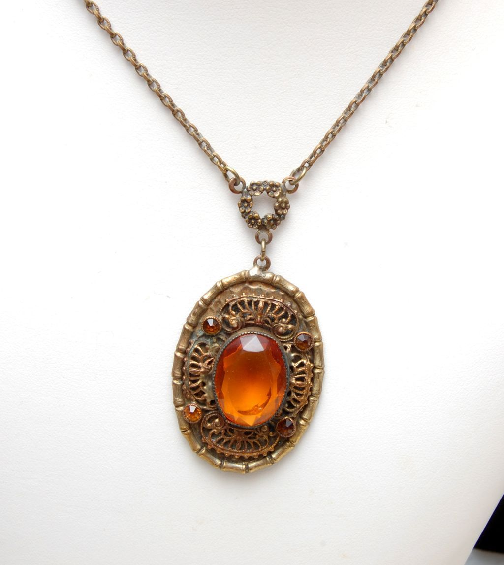 Necklace With Filigree and Faceted Topaz Unfoiled Stones