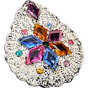 Japanned White Filigree and Unfoiled Rhinestone Dress Clip