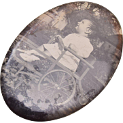 Old Photograph & Mirror of a Child in a Wheel Chair