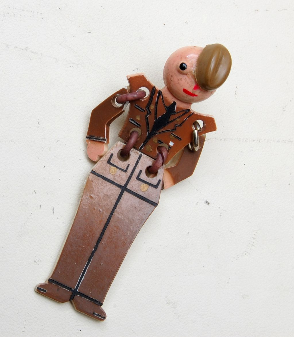 Celluloid Articulated Military Buddy Brooch