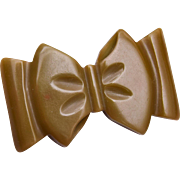 Carved Bakelite Bow Brooch