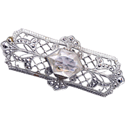 Silver Filigree Brooch with Open  Backed Crystal Center