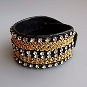 In vogue leather crystals bracelet design. Ethnic and glamour jewelry.