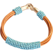 Turquoise beads on natural leather strings cuff bracelet.
