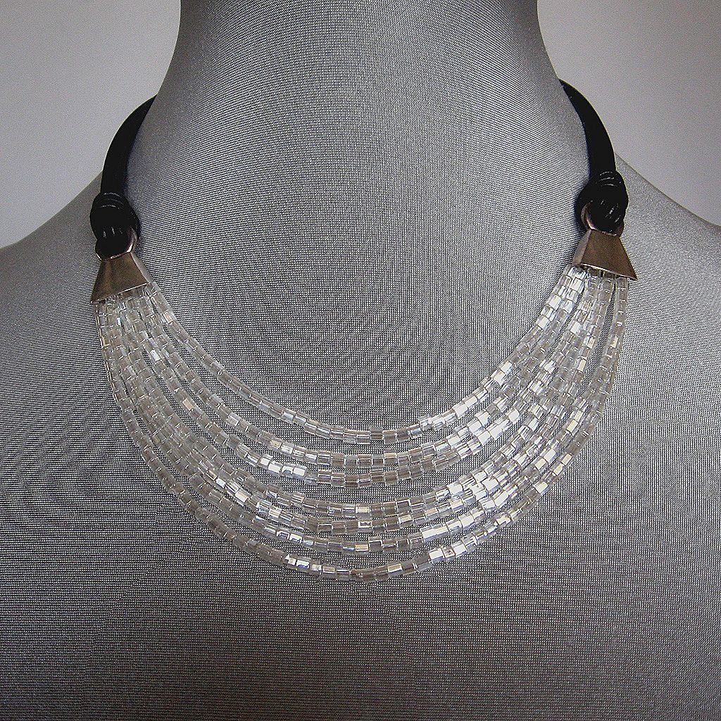 Romantic contemporary jewelry design. Leather necklace, beads fashion.