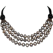 Three strand silvery gray freshwater pearls leather necklace silver clasp