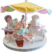 Madame Alexander 75th Anniversary Dionne Quintuplet Dolls on Carousel