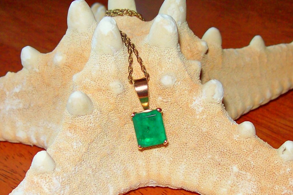 Emerald Cut 3.10  Carat Emerald in 14Kt. Yellow Gold with Vintage Gold Filled Chain