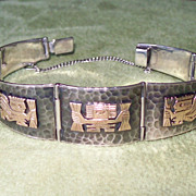Peruvian Silver and 18 Karat Gold Carved Bracelet