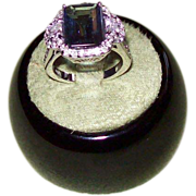 Unique Emerald Cut Tanzanite and Diamond Ring in 14 karat White Gold